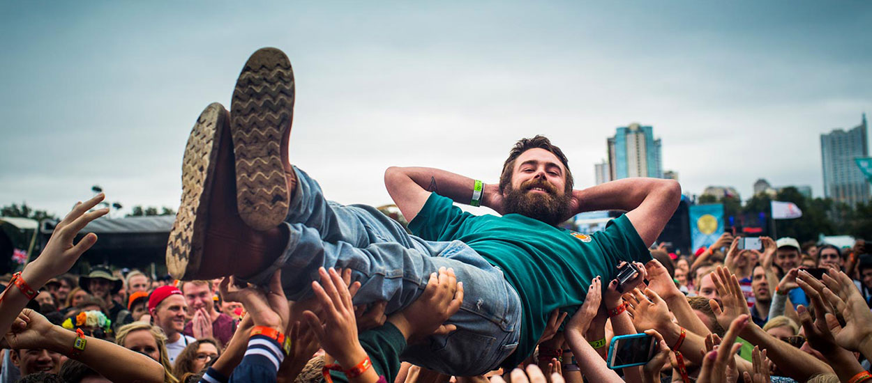 A man crowd surfing at the Austin City Limits Music Festival.